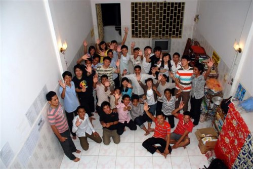 After that, we prayed for them and took a nice group photo. (the houses in Cambodia are such that they're great for taking these kinds of group pics)